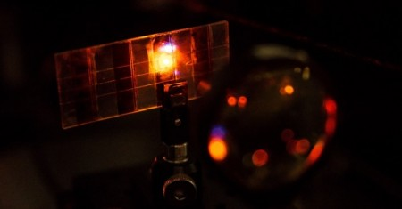 Perovskite Solar Cell Material Emits Light in the Lab.  Click image for the largest view.