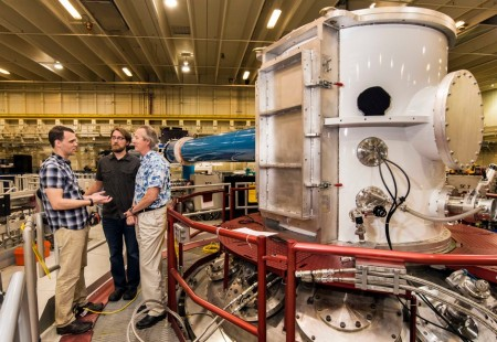 Sandia National Laboratories' Z machine.  Matt Gomez, left, presents an idea to Steve Slutz, right, while Adam Sefkow looks on. Image Credit: Randy Montoya, Sandia National Lab.  Click image for the largest view.