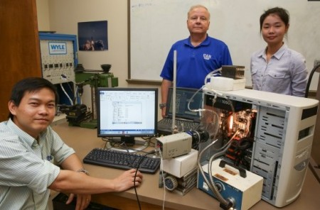 Passive Processor Cooling System. Left to right, Nguyen Smith Wang.  Click image for the largest view.  Image Credit: UAH.