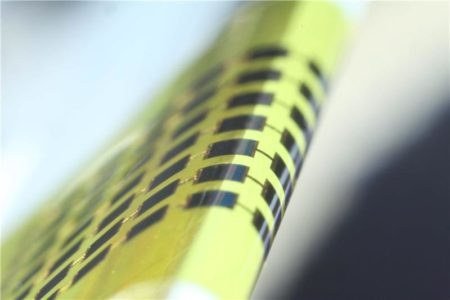 Ultra-thin solar cells are flexible enough to bend around small objects, such as the 1mm-thick edge of a glass slide, as shown here. Image Credit: Juho Kim, et al/ APL. Click image for the largest view.
