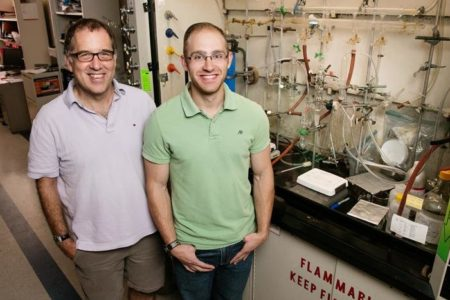 Illinois professor Andrew Gerwith and graduate student Jason Varnell developed a method to isolate active catalyst nanoparticles from a mixture of iron-containing compounds, a finding that could help researchers refine the catalyst to make fuel cells more active. Image Credit: L. Brian Stauffer. Click image for the largest view.