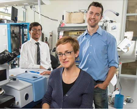 Jillian Buriak (center) worked with post-doctoral fellows Erik Luber (right) and Hosnay Mobarok to create nanoparticles that could lead to printable or spray-on solar cells.