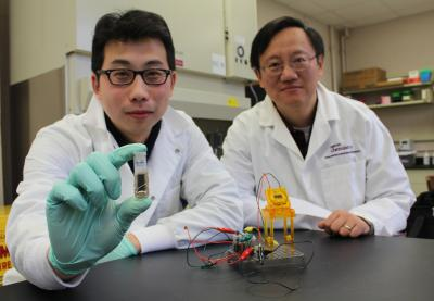 Y.H. Percival Zhang (right), an associate professor of biological systems engineering at Virginia Tech, and Zhiguang Zhu show their new sugar battery.  Click image for the largest view.  Image Credit: Virginia Tech.