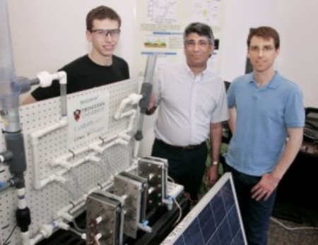The Princeton photovoltaic-electrochemical cell system. With graduate student James White, Professor Andrew Bocarsly and principal engineer Paul Majsztrik from Liquid Light.  Image Credit: Frank Wojciechowski  Click image for the largest view.
