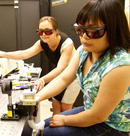 Physics professor Yulia Pushkar (left) and postdoctoral researcher Lifen Yan work in Pushkar's laser lab.  Click image for the largest view.