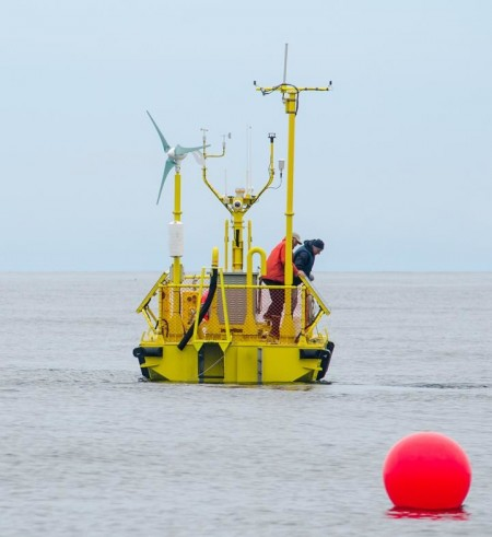 The Ocean Sentinel has been deployed off the Oregon Coast, one of the nation's first wave energy testing devices. Image Credit: Pat Kight, Oregon Sea Grant.  Click image for the largest view.
