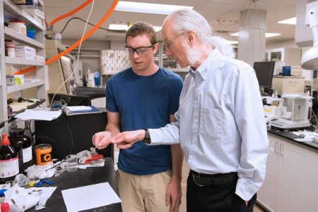 Dan Buttry, professor and chair of ASU's Department of Chemistry and Biochemistry, examines a battery sample with graduate student Tylan Watkins.