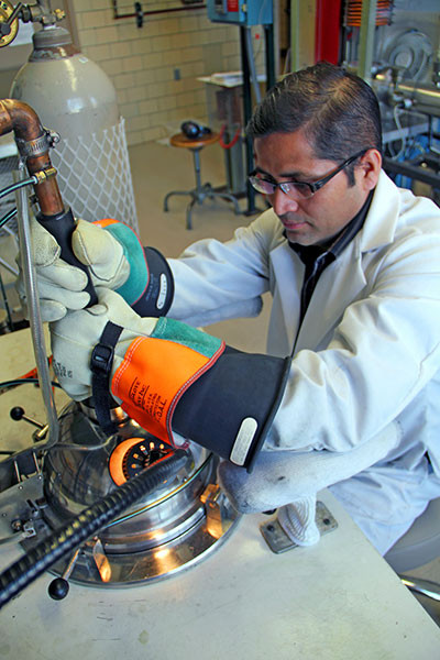 Arc Melting Magnet Material by Arjun Pathak.  Click image for the largest view.  Image Credit: Ames Lab at Iowa State.
