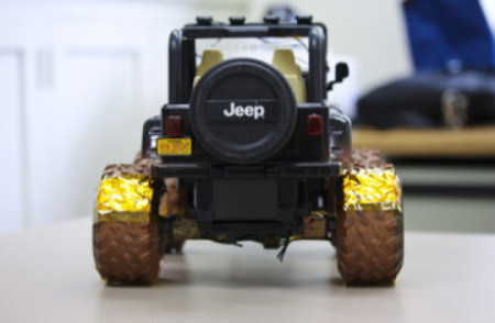 Nanogenerators Mounted to Toy Car Tires.  Click image for the largest view. More info in the study paper and abstract.  Image Credit: University of Wisconsin-Madison.