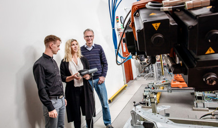 Dr Kristofer Bengtsson, master's student Emma Vidarsson and Professor Bengt Lennartson in the Robotics and Automation Laboratory at Chalmers University of Technology. Image Credit: Oscar Mattsson, Chalmers University. Click image for the largest view.