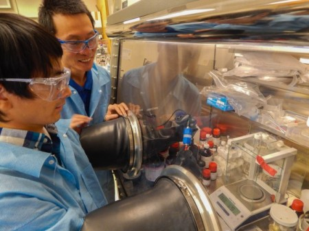 LLNL postdoc Jianchao Ye and Morris Wang work on a lithium ion battery studying the use of hydrogen for longer-lasting batteries. Click image for the largest view. Image Credit: Julie Russell LLNL.
