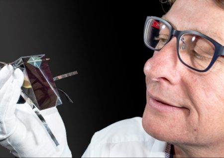 Dr Mark Keevers with one of the spectrum splitting, four-junction mini-modules developed at UNSW. Image Credit: UNSW.