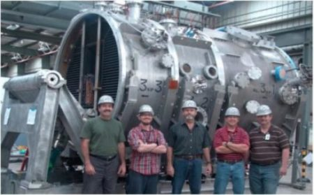 Members of the DIII-D Neutral Beam Group in front of a beam housing for two of the eight beamlines. Image Credit: General Atomics. Click image for the largest view.